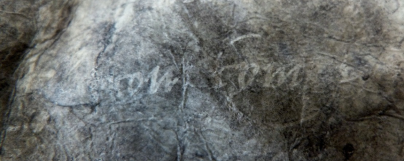 Traces of the ink applied on the surface of the support.